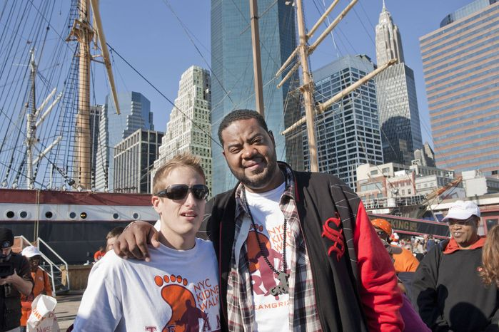 """Ryan Perkins, 23, left, stands with """"30 Rock"""" actor Grizz Chapman in New York City in this undated photo provided by the National Kidney Foundation. Last June, Perkins, who had been in the hospital for nothing more serious than a broken wrist when he was a kid, donated his kidney to Chapman, 36, who suffered from kidney disease for four years, a condition brought on by hypertension. (AP Photo/Courtesy of National Kidney Donation)"""