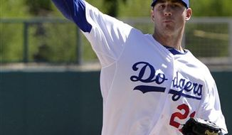 Los Angeles Dodgers starting pitcher Jon Garland throws during the first inning of a spring training baseball game against the Seattle Mariners, Wednesday, March 9, 2011, in Glendale, Ariz. (AP Photo/Nam Y. Huh)