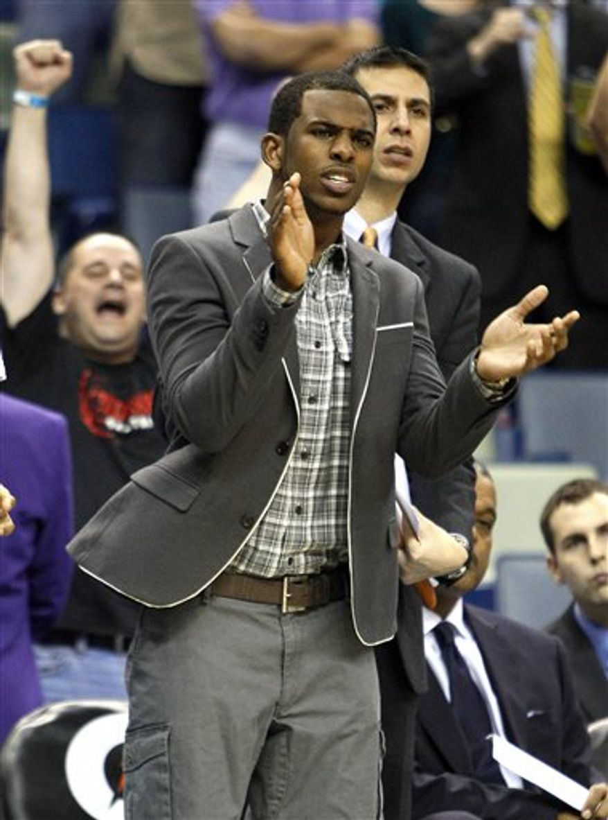 New Orleans Hornets guard Chris Paul reacts after Dallas Mavericks center Tyson Chandler missed a foul shot in the second half of an NBA basketball game in New Orleans, Wednesday, March 9, 2011. Paul is out while he recovers from a concussion. (AP Photo/Patrick Semansky)