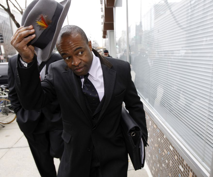 DeMaurice Smith, executive director of the NFL Players Association, removes his hat as he arrives for negotiations with the NFL involving a federal mediator in Washington, Wednesday, March 9, 2011 (AP Photo/Alex Brandon)
