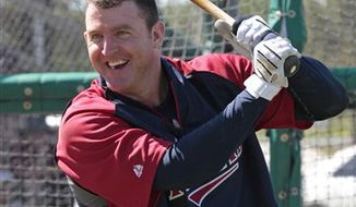FILE - This Feb. 23, 2011, file photo shows Minnesota Twins infielder Jim Thome warming up during spring training baseball workout at the Hammond Stadium complex in Fort Myers, Fla. Thome's back still aches in the morning, just as it has for the past 10 years or so. The older he gets, the more the Minnesota Twins slugger has to do to get those discs and muscles warmed up and ready for another day on the diamond.(AP Photo/Dave Martin, File)