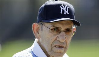FILE - This Feb. 23, 2011, file photo shows New York Yankees Hall of Fame catcher Yogi Berra during a Yankees baseball spring training workout, at Steinbrenner Field in Tampa, Fla. Berra has been taken in an ambulance from the Yankees spring training complex to a hospital following a fall. Yankees general manager Brian Cashman said the 85-year-old former catcher caught one of his sneakers on the carpet in the clubhouse Thursday, march 10, 2011,  and fell on his backside. Cashman said Berra did not fall on his head. (AP Photo/Charlie Neibergall, File)