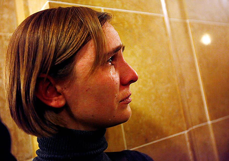 Tears roll down the face of Liz Sanger of Madison, Wis., after the state Senate passed the budget repair bill following a meeting of a state Legislature conference committee at the state Capitol in Madison, Wis., Wednesday evening, March 9, 2011. (AP Photo/Wisconsin State Journal, M.P. King)