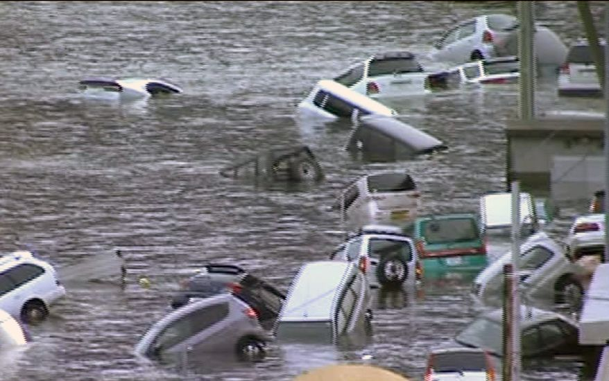 In this image made off Japan's NHK TV video footage, vehicles are washed away by a tsunami in the coastal area of eastern Japan after the country was struck Friday by a magnitude 8.9 earthquake off its northeastern coast. (Associated Press/NHK TV)