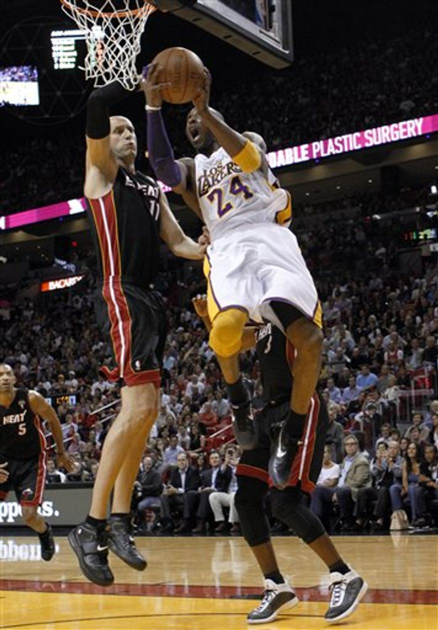 Los Angeles Lakers' Kobe Bryant (24) is fouled by Miami Heat's Zydrunas Ilgauskas (11) during the first half of an NBA basketball game in Miami, Thursday, March 10, 2011. (AP Photo/Alan Diaz)