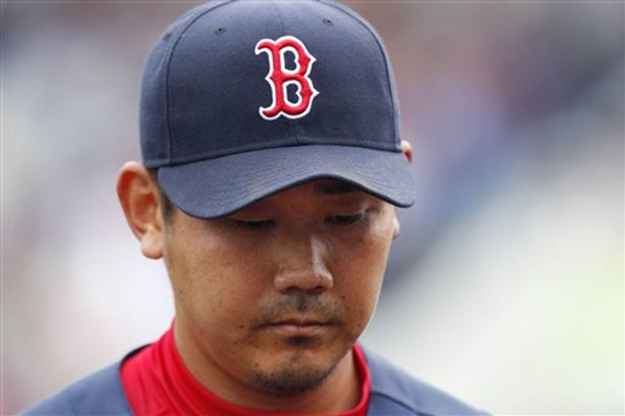 Boston Red Sox starter Daisuke Matsuzaka heads for the dugout after the third inning agains the Tampa Bay Rays in a spring training baseball game in Port Charlotte, Fla., Thursday, March 10, 2011.  Matsuzaka gave up five earned runs in his 3 2/3 inning outing.(AP Photo/Charles Krupa)