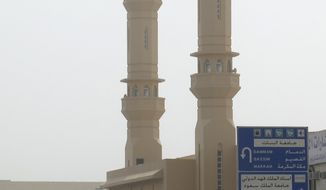 Saudi policemen form a check point inspecting cars near the site where a demonstration is expected to take place in Riyadh, Saudi Arabia, Friday, March 11, 2011. (AP Photo)
