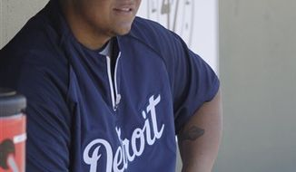 Detroit Tigers first baseman Miguel Cabrera sits in the dugout before a spring training baseball game against the St. Louis Cardinals, Friday, March 11, 2011, in Jupiter, Fla. (AP Photo/Carlos Osorio)