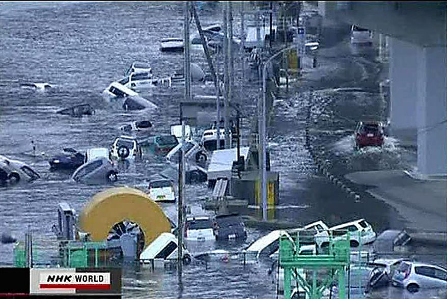 In this video image taken from Japan's NHK TV, cars are washed away in a coastal area of Kamaishi, Iwate prefecture Japan Friday March 11, 2011 following a massive earth quake. A magnitude 8.9 earthquake slammed Japan's northeastern coast Friday, unleashing a 13-foot (4-meter) tsunami that swept boats, cars, buildings and tons of debris miles inland. Fires triggered by the quake burned out of control up and down the coast.  (AP PHOTO/NHK TV)
