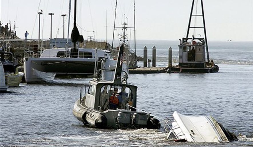 A Santa Cruz Harbor Patrol boat attempts to tow a partially sunken boat in the Santa Cruz Harbor on Friday, March 11, 2011 in Santa Cruz, Calif. A tsunami triggered by the massive earthquake in Japan rushed onto California's coast Friday, causing powerful surges that destroyed boat docks as beach-area residents throughout the state evacuated to higher ground. (AP Photo/Santa Cruz Sentinel, Dan Coyro) **NO SALES MAGS OUT NO TV NO INTERNET MANDATORY CREDIT**