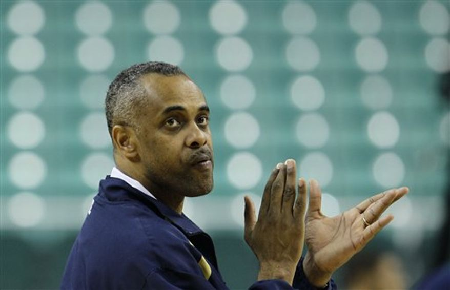 Georgia Tech coach Paul Hewitt applauds his team during NCAA college basketball practice for the upcoming Atlantic Coast Conference tournament in Greensboro, N.C., Wednesday, March 9, 2011. (AP Photo/Gerry Broome)