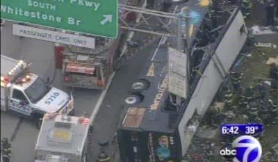 ** FILE ** This image provided by ABC-TV shows the World Wide Tours tour bus after it was sliced by an exit sign on Interstate 95 in the Bronx borough of New York early Saturday, March 12, 2011. (AP Photo/ABC)