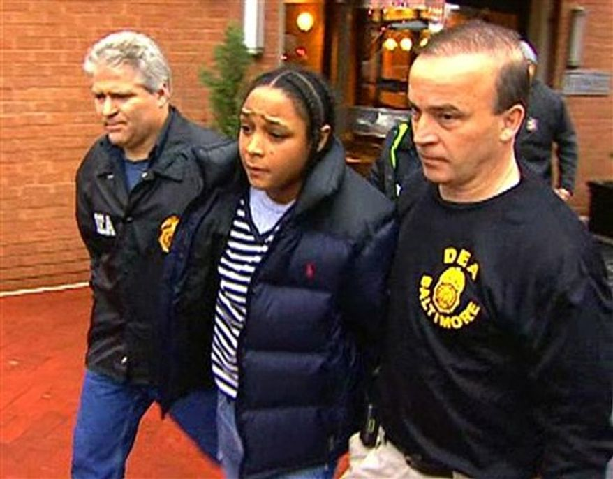 "In this frame grab from video released by WBAL-TV 11, Drug Enforcement Administration agents escort Felicia ""Snoop"" Pearson, who played a killer of the same name on the hit HBO series ""The Wire,"" as she was among dozens arrested in an early morning drug raid, Thursday, March 10, 2011, in Baltimore.  (AP Photo/WBAL-TV 11) MANDATORY CREDIT; NO SALES"
