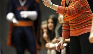 FILE - In this March 21, 2010 file photo, Virginia head coach Debbie Ryan directs her team during the second half of an NCAA first-round college basketball game against Wisconsin-Green Bay in Ames, Iowa. Ryan, who built Virginia's fledgling women's basketball program into a perennial NCAA tournament team and then overcame pancreatic cancer to continue her Hall of Fame career, has resigned after 34 years and 736 victories. (AP Photo/Charlie Neibergall, File))