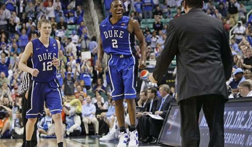 Duke's Nolan Smith (2) and Kyle Singler (12) run toward coach Mike Krzyzewski, right, as they celebrate Duke's 75-58 win over North Carolina in an NCAA college basketball game for the championship of the Atlantic Coast Conference tournament in Greensboro, N.C., Sunday, March 13, 2011. (AP Photo/Gerry Broome)