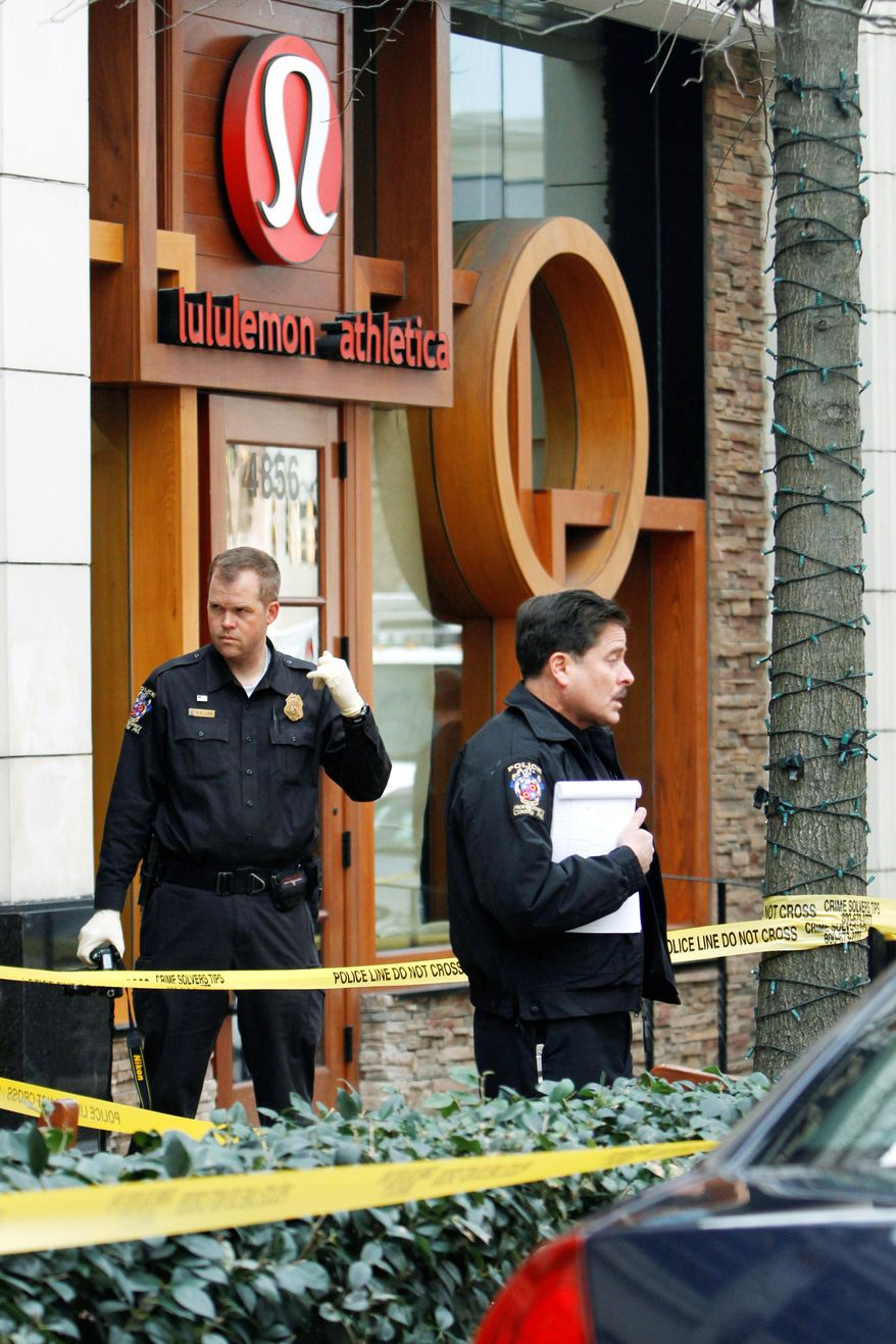 Police work at the scene where a body was found at a Lululemon Athletica store in Bethesda on Saturday, March 12, 2011. (AP Photo)