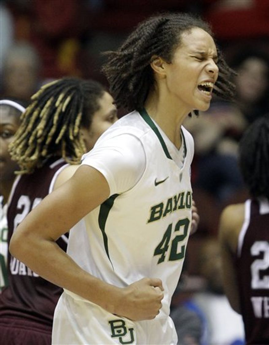Baylor's Brittney Griner, left, blocks a shot by Texas A&M's Tyra White during the second half of an NCAA college basketball game in the championship game at the Big 12 Conference women's tournament on Saturday, March 12, 2011, in Kansas City, Mo. Baylor won 61-58. (AP Photo/Jeff Roberson)