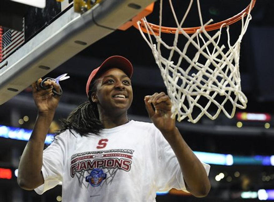 Stanford forward Nnemkadi Ogwumike helps cut down the net after beating UCLA in an NCAA college basketball game at the Pac-10 conference championship, Saturday, March 12, 2011, in Los Angeles. Stanford won 64-55. (AP Photo/Gus Ruelas)