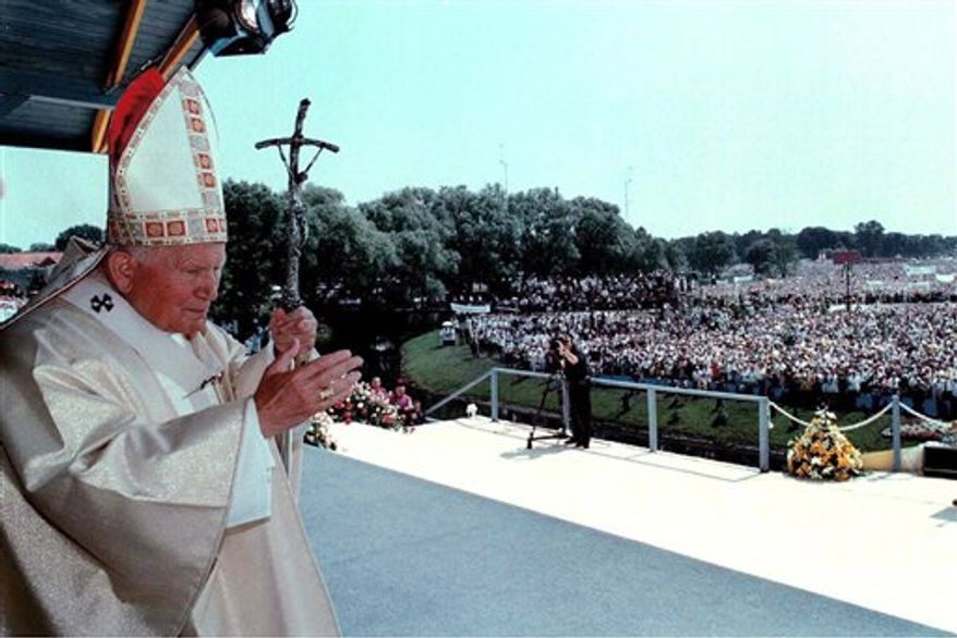 FILE - In this Tuesday, June 8, 1999 file photo, Pope John Paul II waves to the faithful as he arrives to celebrate Mass at the bank of Elk River in Elk, Poland. Thousands of Poles are making plans to travel to Rome for the May 1, 2011 beatification of their beloved countryman, Pope John Paul II, but some have already left, on foot. Two men on Thursday March 10, 2011 began the 900-mile (1,500 kilometer) journey from Olbrachcice Wielkie, in southwestern Poland, planning to walk down Europe's roads and across fields and counting on the support and hospitality of people they meet on the way. (AP Photo/Arturo Mari, Pool)