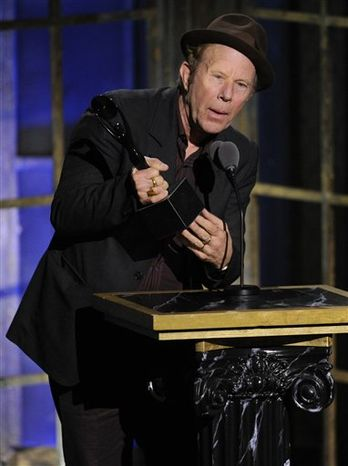 Inductee Tom Waits and his band performs at the Rock and Roll Hall of Fame induction ceremony, Monday, March 14, 2011 in New York. (AP Photo/Evan Agostini)