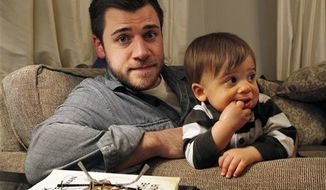 Chris Illuminati, 33, holds his one-year-old son Evan, as they sit in their Lawrenceville, N.J., home Thursday, March 10, 2011. (AP Photo/Mel Evans)