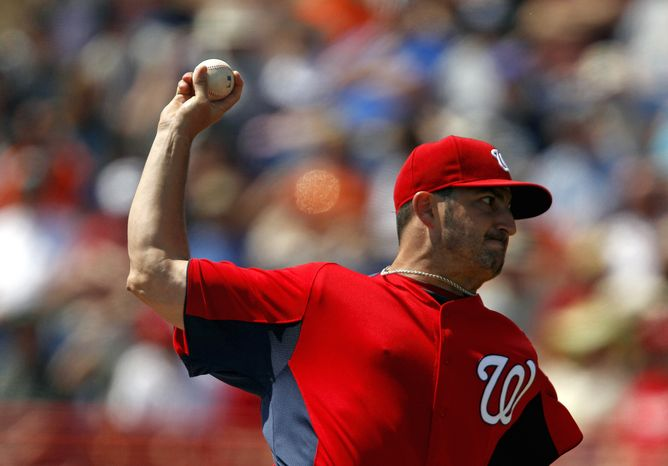 ** FILE ** Washington Nationals starting pitcher Jason Marquis throws a pitch in the first inning of a spring training baseball game against the Detroit Tigers, Monday, March 14, 2011, in Viera, Fla. (AP Photo/David Goldman)