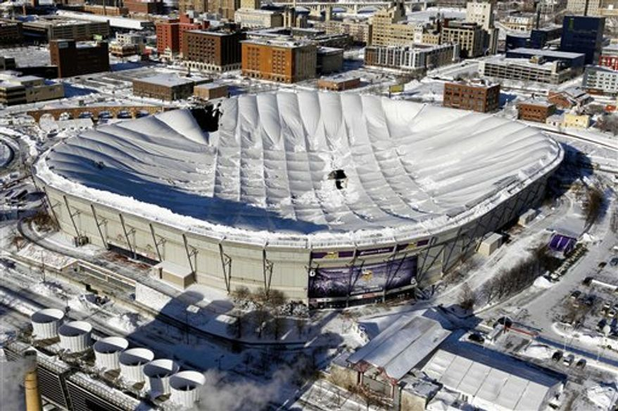 FILE -  In a Dec. 12, 2010 file photo, holes in the collapsed Metrodome roof can be seen in Minneapolis. The inflatable roof collapsed after a snowstorm that dumped 17 inches on Minneapolis. The Vikings want taxpayers to foot more than half the cost for a new stadium to replace the Metrodome but key lawmakers say a statewide tax wouldn't pass the Legislature.  (AP Photo/Ann Heisenfelt, File)