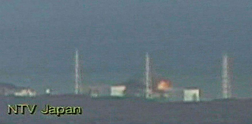 In this image made from Japan's NTV/NNN Japan television footage, flames from the Fukushima Dai-ichi nuclear plant's Unit 3 rise in Okumamachi, Japan, on Monday, March 14, 2011. The second hydrogen explosion in three days rocked the stricken nuclear plant Monday, sending a massive column of smoke into the air and wounding 11 workers. (AP Photo/NTV/NNN Japan)