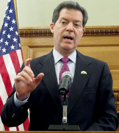 Kansas Gov. Sam Brownback is seeking to fight the demographic forces hollowing out the Farm Belt and to protect Kansas' political clout in Congress. (Associated Press)