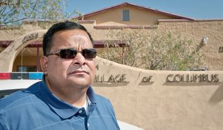 Police Chief Angelo Vega of Columbus, N.M., was among 11 people named in an indictment following an investigation into a firearms-trafficking ring that operated across from a Mexican border town where drug gangs are warring. (Associated Press)