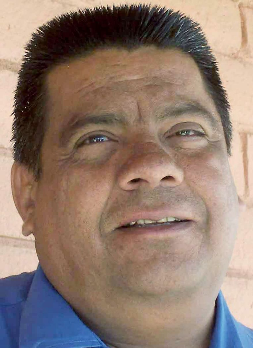 Mayor Eddie Espinoza of Columbus, N.M., was among 11 people named in an indictment following an investigation into a firearms-trafficking ring that operated across from a Mexican border town where drug gangs are warring. (Associated Press)