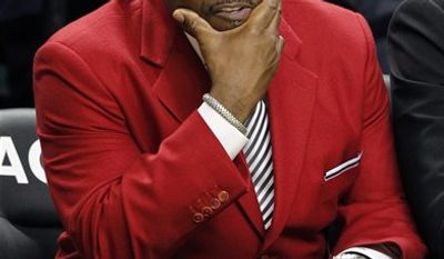 North Carolina State head coach Sidney Lowe sits on the bench late in the second half of their 75-67 loss to Maryland in an NCAA college basketball game at the Atlantic Coast Conference tournament in Greensboro, N.C., Thursday, March 10, 2011. (AP Photo/Bob Leverone)