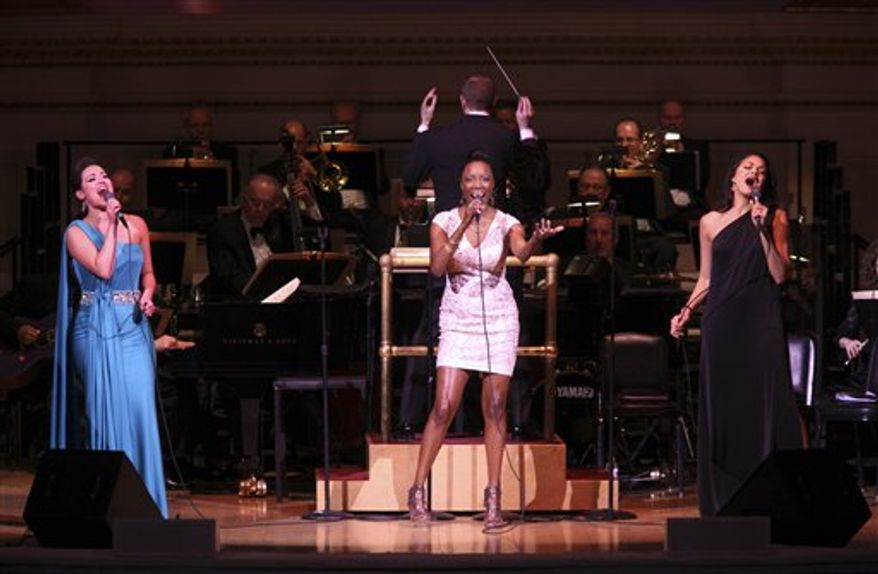 "This Friday, March 11, 2011 photo courtesy of Steve J. Sherman for Carnegie Hall shows, from left to right, Ashley Brown, Heather Headley and Karen Olivo as they perform with The New York Pops during a performance honoring Judy Garland at Carnegie Hall in New York. They performed  ""Over the Rainbow,"" ""The Trolley Song,"" ""The Man That Got Away,"" and other songs  from Garland's 1961 Carnegie Hall performance.   (AP Photo/Carnegie Hall, Steve J. Sherman) NO SALES"