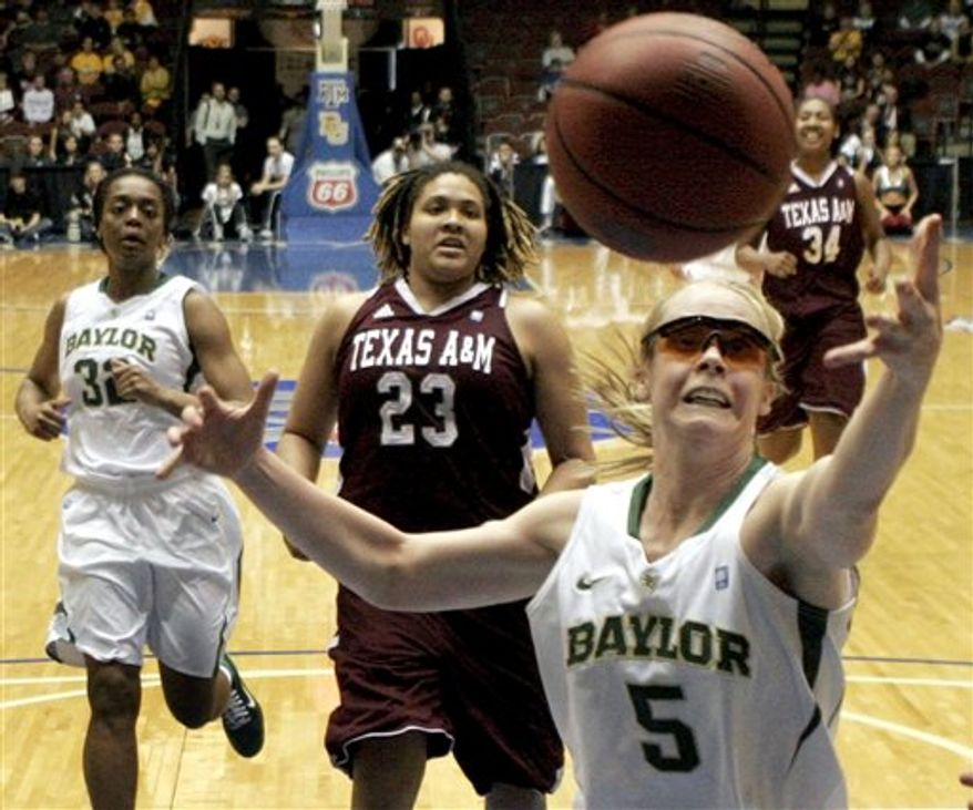 Baylor's Melissa Jones (5) reaches for a rebound as Texas A&M's Danielle Adams (23) and Baylor's Brooklyn Pope look on during the first half of an NCAA college basketball game in the championship game at the Big 12 Conference women's tournament on Saturday, March 12, 2011, in Kansas City, Mo. (AP Photo/Jeff Roberson)