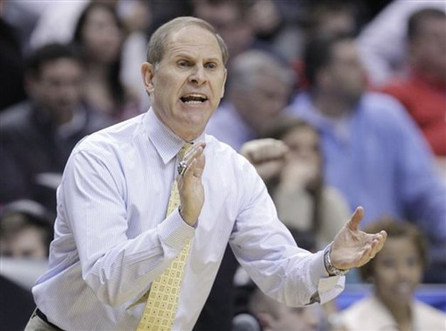 Michigan head coach John Beilein directs his team in the first half of an NCAA college basketball game against Ohio State in the semifinals of the Big Ten Conference tournament in Indianapolis, Saturday, March 12, 2011.  (AP Photo/Michael Conroy)