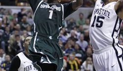 Michigan State guard Kalin Lucas (1) drives the ball against Penn State guard Tim Frazier (23) in the first half of an NCAA college basketball game in the semifinals of the Big Ten Conference tournament in Indianapolis, Saturday, March 12, 2011.  (AP Photo/Kiichiro Sato)