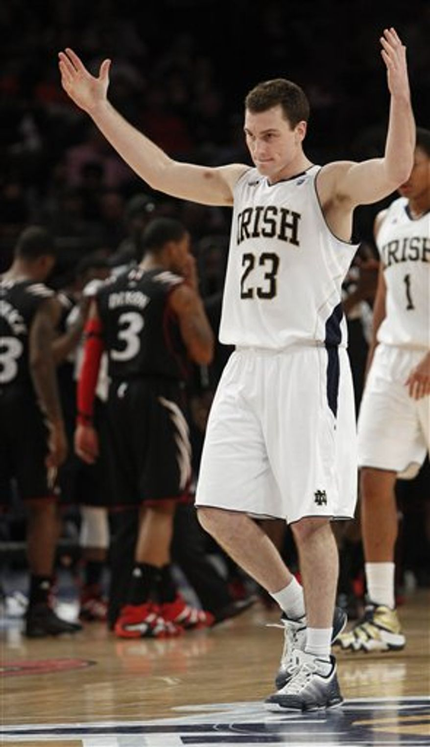 Notre Dame's Ben Hansbrough (23) reacts to the crowd during the second half of an NCAA college basketball game against Cincinnati at the Big East Championship, Thursday, March 10, 2011, in New York. Notre Dame won the game 89-51. (AP Photo/Frank Franklin II)