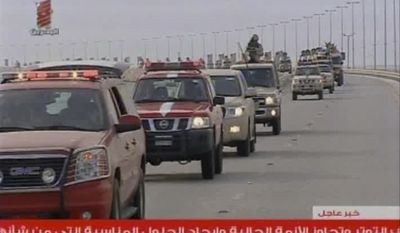This screen grab from Bahrain TV shows troops arriving in Bahrain from Saudi Arabia on Monday, March 14, 2011. The Saudi-led military forces were deployed to prop up the Bahraini monarchy against widening demonstrations, launching the first cross-border military operation to quell unrest since the Arab world's rebellions began in December. (AP Photo/Bahrain TV via APTN)