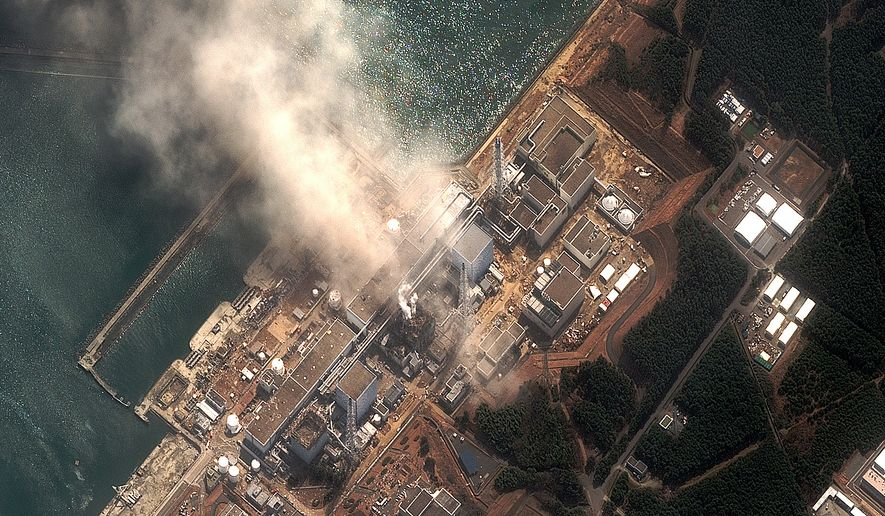 This satellite image provided by DigitalGlobe shows the damaged Fukushima Dai-ichi nuclear facility in northeastern Japan on Monday, March 14, 2011. (AP Photo/DigitalGlobe)