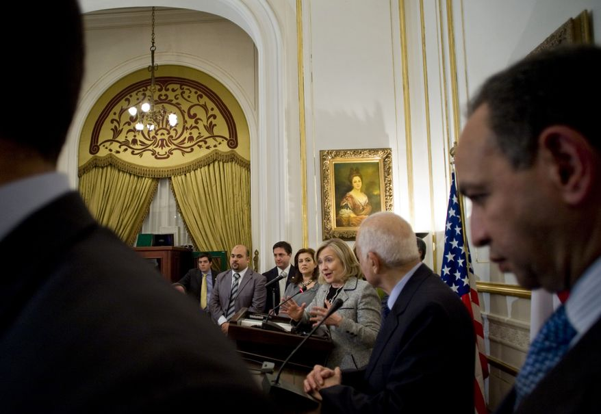 U.S. Secretary of State Hillary Rodham Clinton (center) speaks during a joint press conference with Egyptian Foreign Minister Nabil el-Arabi (second from right) after their meeting in Cairo on Tuesday, March 15, 2011. Mrs. Clinton pressed Egypt's transitional leaders to follow through on pledges for democratic reform after the ouster of the country's longtime autocratic president in a popular revolt. (AP Photo/Grace Kassab)