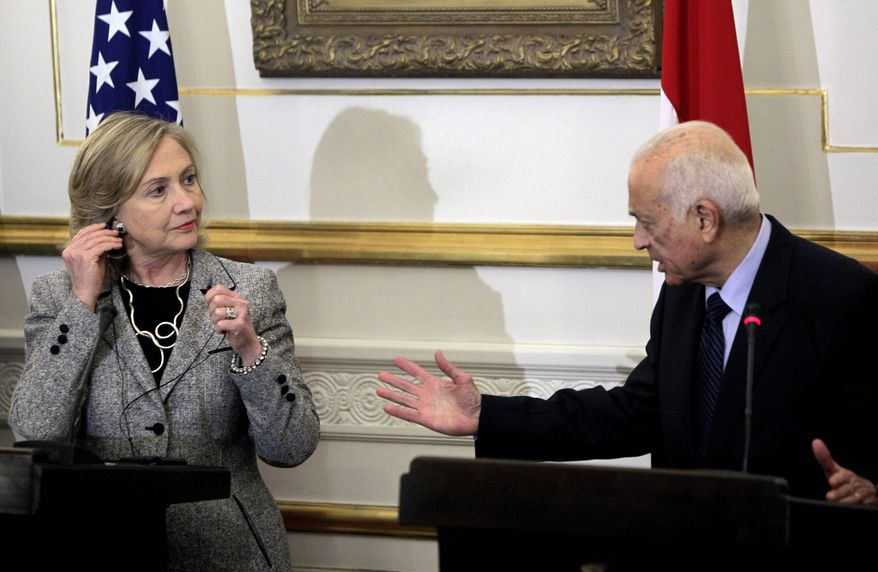 U.S. Secretary of State Hillary Rodham Clinton talks with Egyptian Foreign Minister Nabil el-Arabi during a media presentation in Cairo on Tuesday, March 15, 2011. Mrs. Clinton is pressing Egypt's transitional leaders to follow through on pledges for democratic reforms after the ousting of the country's longtime autocratic president in a recent popular revolt. (AP Photo/Amr Nabil)