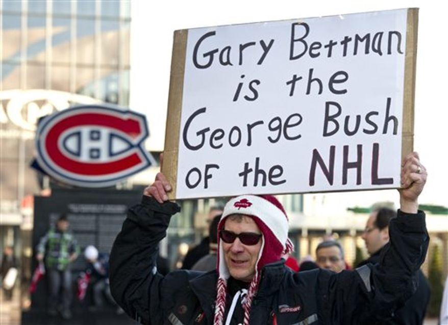 A demonstrator holds up a sign during a protest against violence in hockey and demanding tougher sanctions from the NHL against hits to the head, Tuesday, March 15, 2011, in Montreal. (AP Photo/The Canadian Press, Paul Chiasson)
