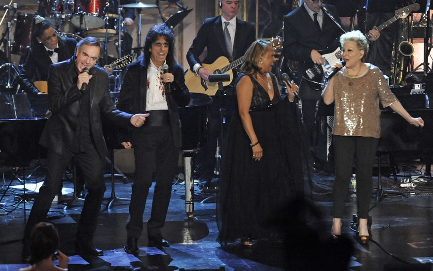 Inductees (from left) Neil Diamond, Alice Cooper and Darlene Love join Bette Midler in performance at the Rock and Roll Hall of Fame induction ceremony on Tuesday, March 15, 2011, in New York. (AP Photo/Evan Agostini)