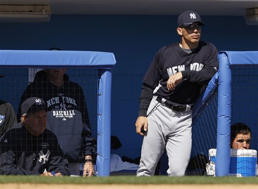 New York Yankees' Nick Swisher breaks his bat grounding into a first-inning double play in the Yankees' 6-5 loss to the Toronto Blue Jays in their spring training baseball game at Florida Auto Exchange Stadium in Dunedin, Fla., Friday, March 18, 2011.  (AP Photo)