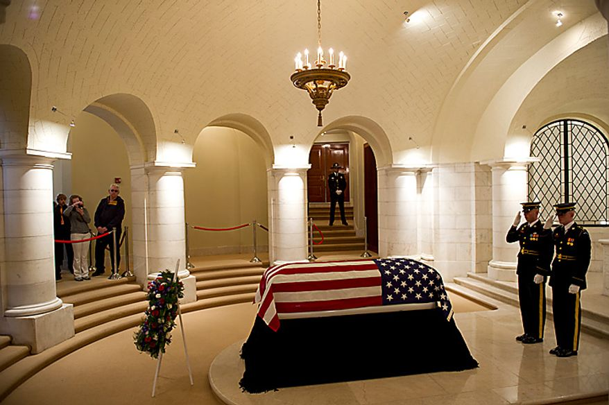 "The U.S. Army's 3rd Infantry Regiment, ""The Old Guard,"" changes the guard as the body of former Army Cpl. Frank Woodruff Buckles, the last surviving American veteran of World War I, lies in honor in the Memorial Amphitheater Chapel at Arlington National Cemetery in Arlington, Va., on Tuesday, March 15, 2011. (Rod Lamkey Jr./The Washington Times)"