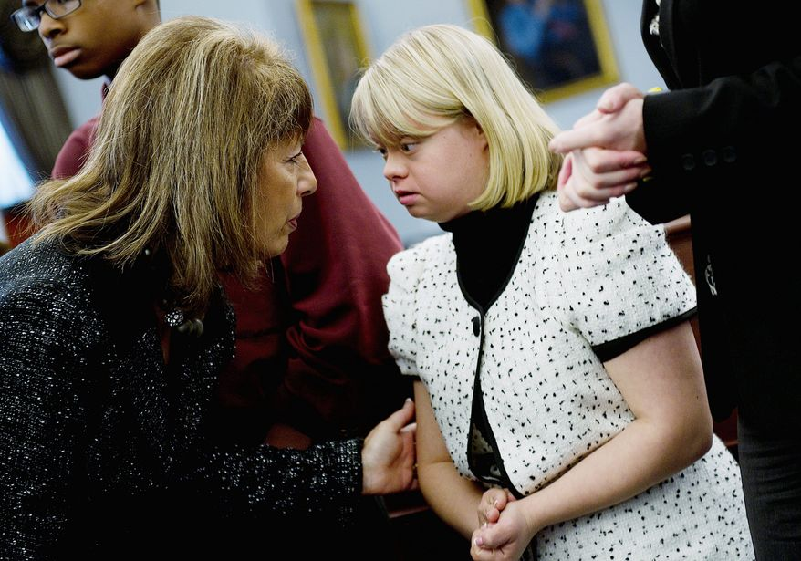 Rep. Jackie Speier, California Democrat, talks with TV actress Lauren Potter (right) during a congressional briefing Wednesday on bullying children with special needs. Miss Potter has Down syndrome. (Barbara L. Salisbury/The Washington Times)