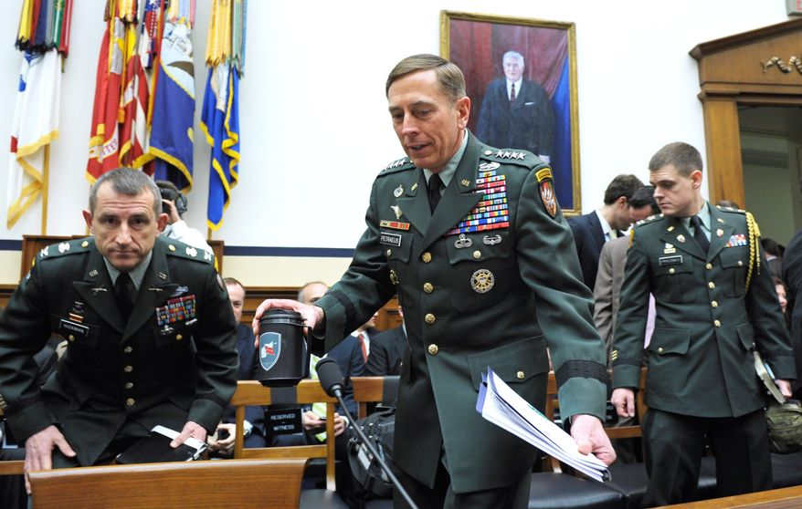 Gen. David H. Petraeus (center) arrives on Capitol Hill on Wednesday to testify before the House Armed Service Committee. (Associated Press)