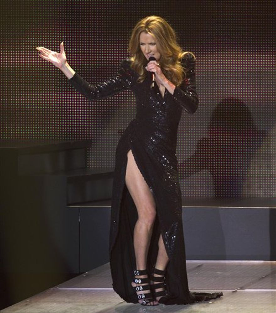 Celine Dion sings a montage from James Bond movies during her opening night performance at Caesar's Palace, Tuesday, March 15, 2011, in Las Vegas. (AP Photo/Julie Jacobson)