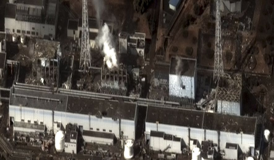 This satellite photo taken on Wednesday, March 16, 2011, and provided by DigitalGlobe shows the damage to the reactor buildings of Units 1, 3 and 4 at the Fukushima Dai-ichi nuclear power plant in northeast Japan. Steam can be seen venting from the Unit 2 reactor building, as well as from the Unit 3 reactor building. (AP Photo/DigitalGlobe)