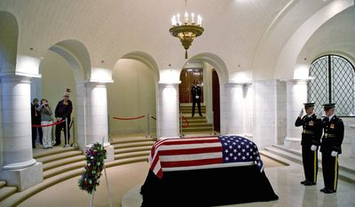 Members of the U.S. Army's 3rd Infantry Regiment pay respects at the casket of Frank W. Buckles, the last surviving American veteran of World War I, in the Memorial Amphitheater Chapel at Arlington National Cemetery in Arlington, Va., on Tuesday. Buckles died Feb. 27, 2011, in West Virginia at age 110. (Associated Press)